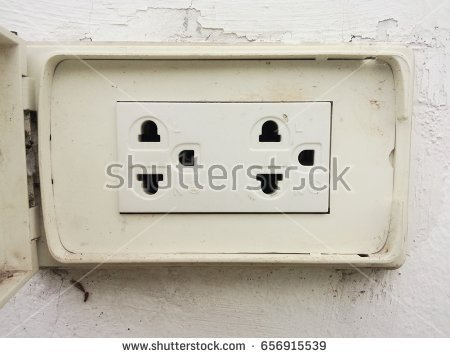 Old Electrical Outlet On A White Wall